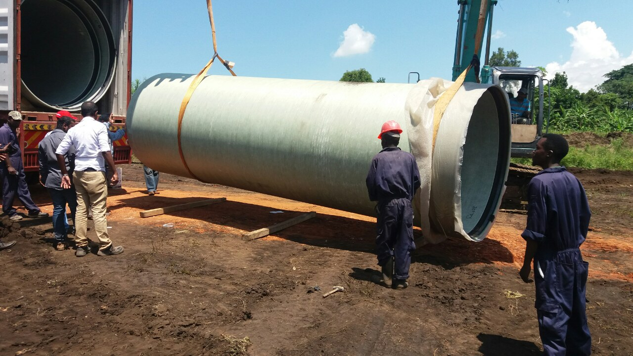 DN2200mm and below GRP Pipes Unloading- Rwimi-Uganda-1